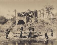 PHOTOGRAPH OF WOMAN FETCHING WATER FROM THE EDGE OF THE NILE RIVER -ORIGINAL