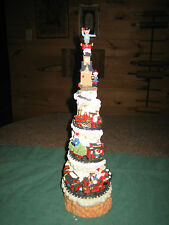 """LIGHTED MUSICAL CHRISTMAS  TRAIN W/ SANTA & HIS ELF'S ON IT~STANDS 15 1/2"""" TALL"""
