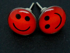A PAIR OF RED SMILEY FACE  THEMED STUD EARRINGS. NEW.