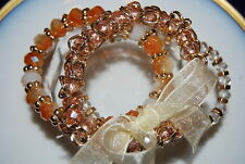 SET OF THREE GOLD TONED METAL CRYSTALS AND NATURAL STONES STRETCH CUFF BRACELETS