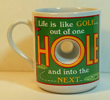 Golf Mug Life is Like Golf Has See Through Hole in Side of Coffee Cup by Papel