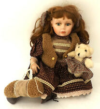 KNIGHTSBRIDGE COLLECTION PORCELAIN SITTING DOLL HOLDING TEDDY AND BAG
