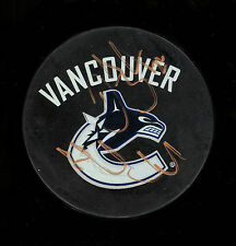 VANCOUVER CANUCKS DANIEL AND HENRIK SEDIN SIGNED AUTOGRAPH AUTO IN GOLD ON PUCK