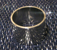 Great simple wide ring in silver tone metal.
