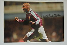 2) A 12 x 8 inch photo personally signed by Trevor Sinclair of West Ham United.