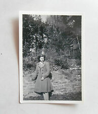 Vintage 1940s B/W Photograph. Woman in a 40s Tailored Coat. Winter Garden