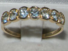 UNUSUAL 9CT 9K  GOLD 7 STONE AQUAMARINE ETERNITY RING
