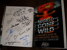 World Gone Wild hardcover book signed by author David J. Moore + 16 others