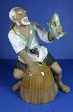 ORIENTAL CHINESE SHIWAN MUD MAN FIGURINE FISHERMAN WITH A FISH