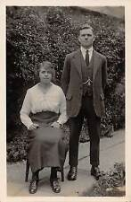 Young man & woman, garden photo c 1912, W.H.Major, Peterborough  L1786