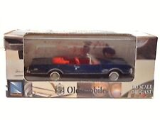 New-Ray 1966 Blue Oldsmobile Cutlass 4-4-2 1:43 Die-Cast Toy Car. 2004. New.