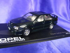 OPEL LOTUS OMEGA 1989-1992 OP07 1:43 NEW MODEL CAR DARK GREEN VAUXHALL CARLTON