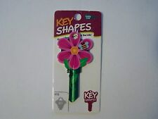 Flower Schlage house key blank.