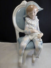 Lladro # 1229 - Young Harlequin Boy on chair with cat -  excellent