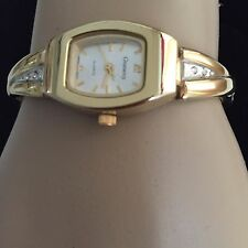 PRETTY GRAMERCY LADIES WRIST WATCH WITH RHINESTONES ON GOLD STRETCH BAND