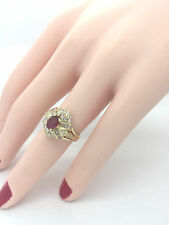 Ladies Oval Ruby and Round and Baguette Diamond 1.50 Carat 14K Yellow Gold Ring