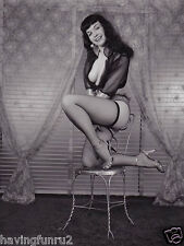 1956 Bettie Page posing on metal chair in fishnets 5 x 7 Photograph