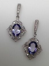 New 10K White Gold Oval Shape Natural Tanzanite and 0.25ct Diamond Earrings