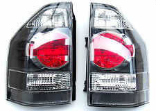 MITSUBISHI PAJERO SHOGUN MONTERO rear tail set lights 2003-2006 LH+RH BLACK