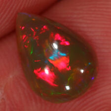 2ct Natural Untrated Dark Crystal Lots of Red Fire Ethiopian Welo Opal Pear Cab