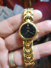 Women's Gold Tone SEIKO Watch WITH GOLD TONE BAND AND BLACK FACE