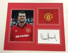 A 12 x 10 inch mounted display signed by Gary Pallister of  Manchester United.