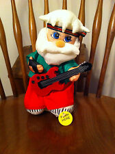 Gemmy Santa Claus Figure Playing Heavy Metal Guitar Christmas Jingle Bells used