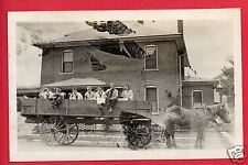 RPPC 7 PEOPLE IN HORSE DRAWN WAGON DRINKING OUT OF BOTTES POP SODA RPPC