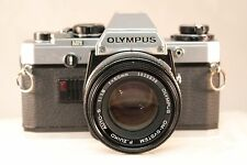 Olympus OM-10 35mm SLR Camera w/ 50 mm F. Zuiko f1.8 lens TESTED #1095885