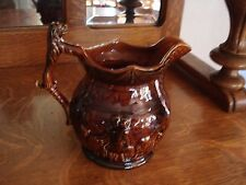 Arthur Wood Ceramic Brown Pitcher Embossed Scene of Man with Lions/Lion Handle