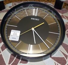 "SEIKO BLACK CASE 12"" IN DIAMETER  WALL CLOCK W/ QUIET SWEEP SECOND  QXA612KLH"