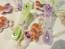 PRETTY MEMO OR PHOTO HOLDER STRING WITH FLOWER PEGS & BUTTERFLIES..............C