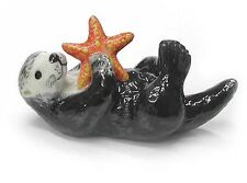R128B - Northern Rose  Sea Otter Pup with Starfish