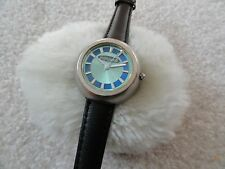 Ladies Dollhouse Quartz Watch with a Black Leather Band