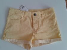 H&M shorts. Size 8. Yellow divided. New with tags