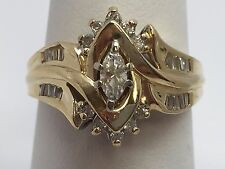 14K YELLOW GOLD 3/8 TCW MARQUISE W ROUND BAGUETTE DIAMONDS RING