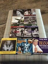 12 ASSORTED PROMOTIONAL NEWSPAPER DVD's