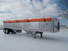 DCP 1/64 SCALE WILSON GRAIN TRAILER CHROME WITH ORANGE TARP AND SILVER HOPPERS