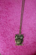 Long, brass, owl necklace from Sfera