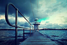 Framed Print - Lighthouse at the End of a Wooden Ocean Pier (Picture Poster Art)