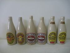 7 stoneware beer bottles with labels. Port Dundas Glasgow sold as each 1 bottle