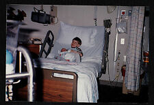 Vintage Photograph Little Boy in Hospital Bed Holding Baby - Crazy Eyes