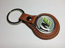 WE AIRSOFT ` GUNS / FIREARMS  `LEATHER KEY RING: BLACK OR TAN