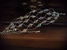 Woven wire Multi Strand AB Faceted Real Crystal Bracelet. Adjustable