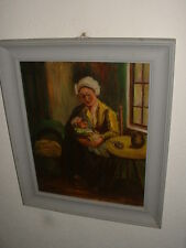 Old oil painting on canvas,{ Mother with her baby, is signed }