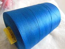 bobine cone 7000 métres GUTTERMAN  polyester surjeteuse Bleu coloris 214