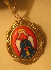 Delightful Swirl Rimmed Goldtone Christmas Angel Blowing a Horn Pendant Necklace