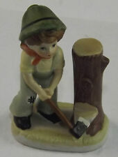 Young Lumberjack Boy Figurine Chopping Down The Tree Stump Porcelain Bisque
