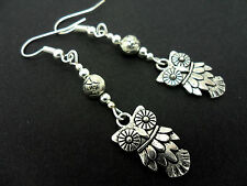 A PAIR OF TIBETAN SILVER  DANGLY OWL THEMED   EARRINGS. NEW.