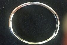 "18k white gold polished faceted bangle bracelet,  7.5"", 7.0 grams"